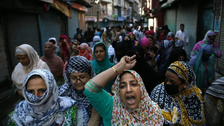 Kashmiri Muslim women shout pro freedom slogan during a protest march in Srinagar, Indian controlled Kashmir, Friday, Aug. 26, 2016. Curfew and protests have continued across the valley amidst outrage over the killing of a top rebel leader by Indian troops in early July, 2016. (AP Photo/Mukhtar Khan)