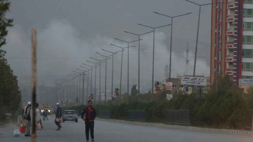 Smoke rises from a complex after an attack on the American University of Afghanistan in Kabul, Afghanistan, Thursday, Aug. 25, 2016. The attack has ended, a senior police officer said Thursday, after several people were killed. Kabul police Chief Abdul Rahman Rahimi said the dead included one guard, and that about 700 students had been rescued. (AP Photo/Rahmat Gul)