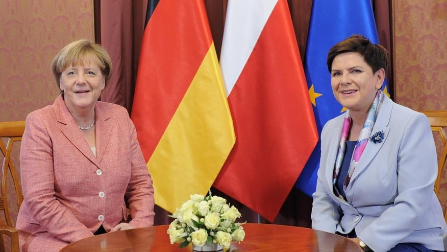 German Chancellor Angela Merkel, left, and Polish Prime Minister Beata Szydlo stop for a photo prior to talks in Warsaw, Poland, Friday, Aug. 26, 2016. Merkel came to Warsaw to meet prime ministers of Poland, Hungary, Czech Republic and Slovakia. (AP Photo/Alik Keplicz)