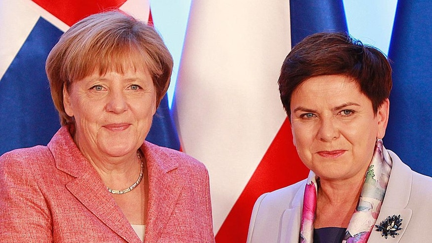 German Chancellor Angela Merkel,left, is greeted by Poland's Prime Minister Beata Szydlo in Warsaw, Poland, Friday, Aug. 26, 2016., as she arrives for talks with four central European leaders about the shape of the European Union after Britain leaves and about migrants, ahead of an EU summit planned next month.(AP Photo/Czarek Sokolowski)