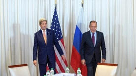 U.S. Secretary of State John Kerry, left, and Russian Foreign Minister Sergei Lavrov, right, walk to their seats prior to a bilateral meeting  in Geneva, Switzerland, Friday, Aug. 26, 2016. The U.S. and Russia renewed efforts to secure a military and humanitarian cooperation agreement for war-torn Syria as conditions on the ground continued to deteriorate after months of hesitation, missed deadlines and failed attempts to forge a nationwide truce. (Martial Trezzini/Pool Photo via AP)