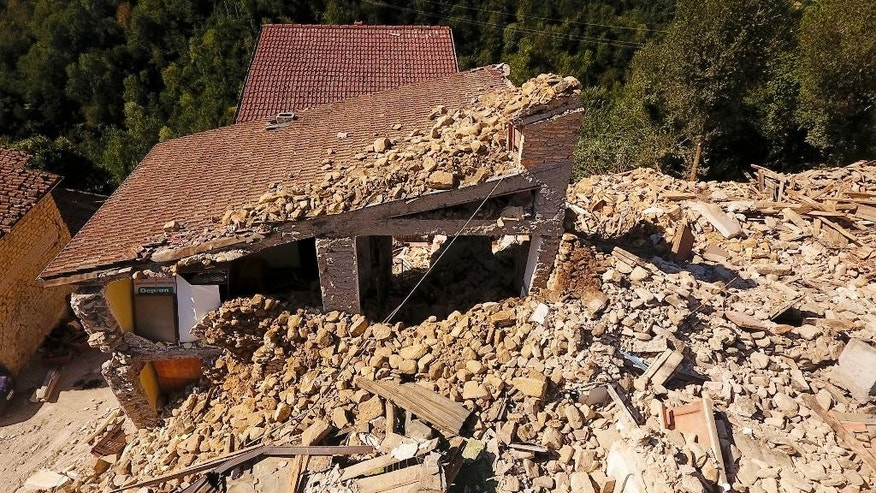 Aerial view of the village of Saletta in central Italy, Friday, Aug. 26, 2016, where a strong quake hit early Wednesday. Strong aftershocks rattled residents and rescue crews alike Friday as hopes began to dim that firefighters would find any more survivors as donations began pouring into the area and Italy again anguished over its failure to protect ancient towns and modern cities from the country's highly seismic terrain. (AP Photo/Localteam)