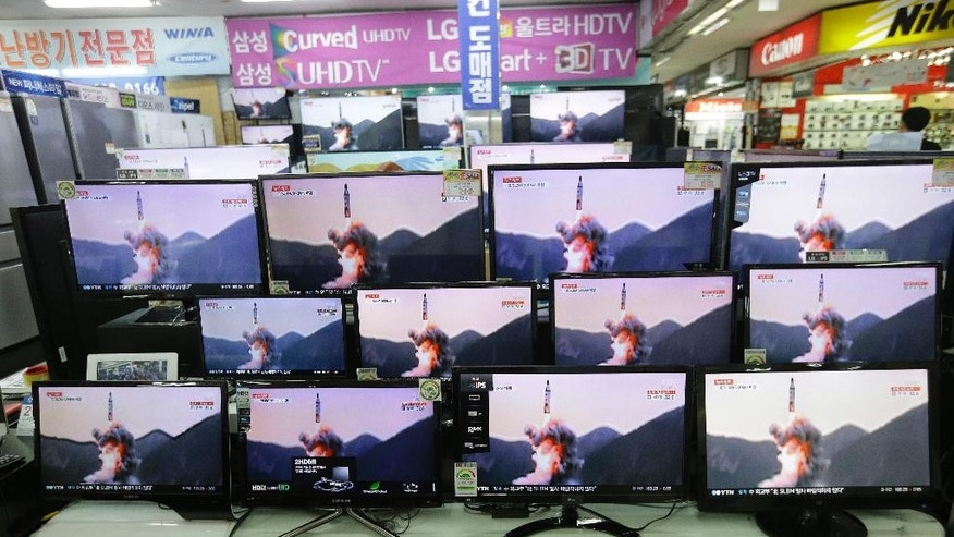 "FILE - In this Wednesday, Aug. 24, 2016, fie photo, TV screens show file footage of a North Korea's ballistic missile that North Korea claimed to have launched from underwater at the Yongsan Electronic store in Seoul, South Korea. North Korea has expressed anger at United Nations Security Council discussions over a statement denouncing the country's latest submarine-launched missile test. North Korean Foreign Ministry official Jon Min Dok said in an interview Saturday that the U.S.-led discussions at the U.N. were a ""terrible provocation"" and that the country is developing nuclear weapons because of ""outrageous nuclear intimidation"" by the United States. (AP Photo/Ahn Young-joon, File)"