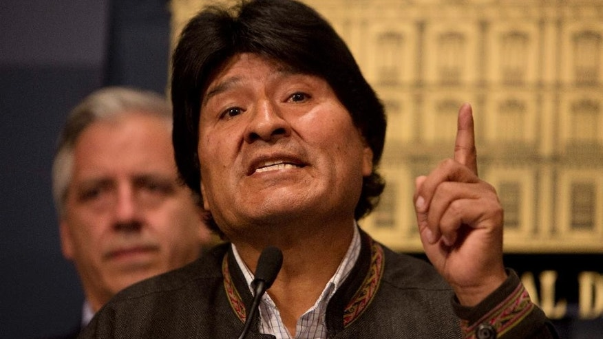 "Bolivia's President Evo Morales speaks during a press conference at the government palace in La Paz, Bolivia Friday, Aug. 26, 2016. Striking miners in Bolivia armed with dynamite seized highways in a protest over mining laws and then kidnapped, possibly tortured and beat to death the county's deputy interior minister in a killing President Evo Morales characterized Friday as a ""political conspiracy,"". (AP Photo/Juan Karita)"