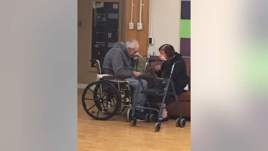 In this Monday, Aug. 22, 2016 photo provided by Ashley Bartyik, her grandparents Wolfram and Anita Gottschalk of Surrey, British Columbia, Canada, cry as they say goodbye near the end of a visit with each other in Wolfram's elderly care home in Surrey. The couple, who are in their 80s, were separated into two different care homes a half an hour apart after 62 years of marriage because no beds were available together. (Ashley Bartyik via AP)