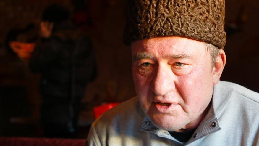In this photo taken on Monday, Jan. 25, 2016, a Crimean Tatar leader, Ilmi Umerov, speaks during an interview to the Associated Press in Simferopol, Crimea. An international rights group has urged Russia to release Umerov who has been sent to a psychiatric hospital. (AP Photo/Sergei Grits)