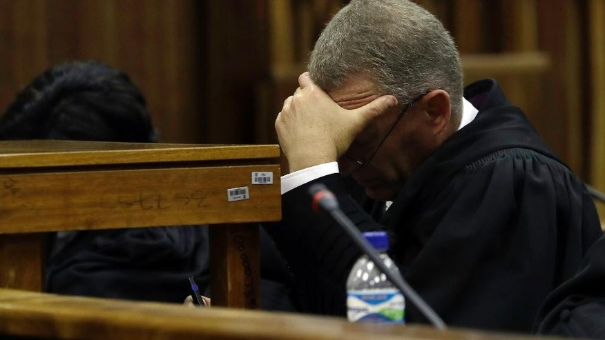 South African chief state prosecutor Gerrie Nel, reatcs as Judge Thokozile Masipa, reads her verdict during the state appeal hearing at the high court in Johannesburg, South Africa, Friday, Aug. 26, 2016. The State lost it's appeal challenging Masipa's six years prison sentence on Oscar Pistorius for the murder of his girlfriend, Reeva Steenkamp. (AP Photo/Themba Hadebe/POOL)