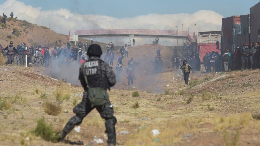 Independent miners clash with the police during  protests in Panduro, Bolivia, Thursday, Aug. 25, 2016.
