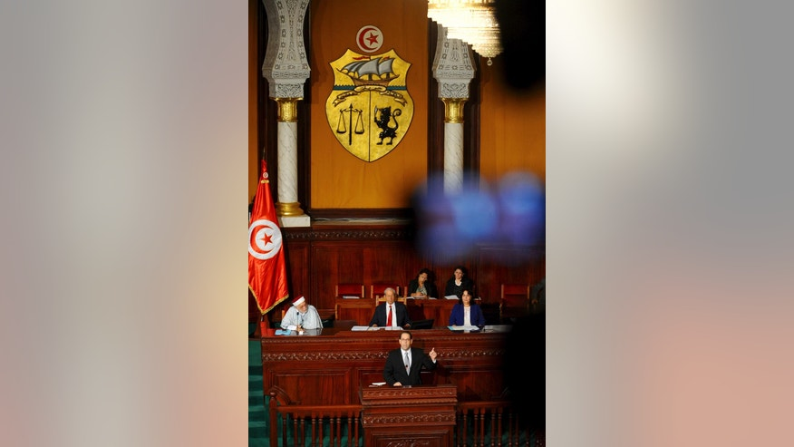 Newly named Tunisian Prime Minister Youssef Chahed Youssef delivers his speech at f the Parliament in Tunis, Friday Aug. 26, 2016 ahead of a confidence vote. Chahed, 41, was minister for local affairs in the government of Habib Essid that fell last month. (AP Photo/Riadh Dridi)
