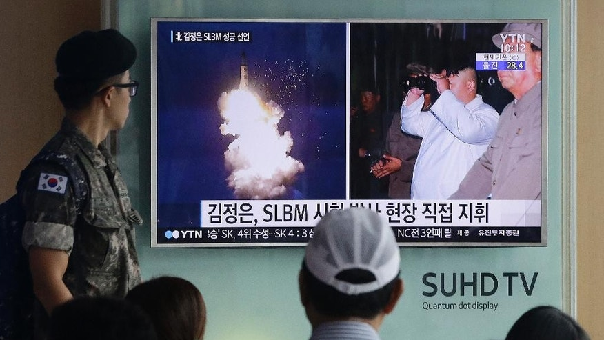 "FILE - In this Thursday, Aug. 25, 2016, file photo, a South Korean army soldier watches a TV news program showing images published in North Korea's Rodong Sinmun newspaper of North Korea's ballistic missile believed to have been launched from underwater and North Korean leader Kim Jong-un, at Seoul Railway station in Seoul, South Korea. The UN Security Council is strongly condemning four North Korean ballistic missile launches in July and August, calling them ""grave violations"" of a ban on all ballistic missile activity. A press statement approved by all 15 members Friday night deplored the fact that the North's ballistic missile activities are contributing to its development of nuclear weapon delivery systems and increasing tensions. (AP Photo/Ahn Young-joon, File)"