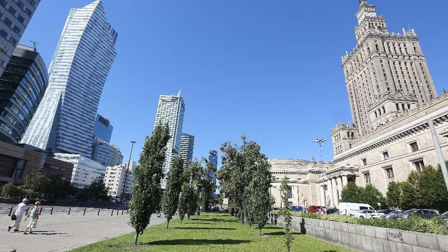A plot of land by the landmark Palace of Culture and Science in downtown Warsaw, Poland, Friday, Aug. 26, 2016., that is at the center of a media storm over irregularities in the restitution of private property seized by the communists into private hands. Warsaw Mayor Hanna Gronkiewicz-Waltz said Friday she fired three officials for what she described as lax oversight over the town hall's decisions to return the plot, of estimated value of some $42 million, and of other property. Documents indicate the plot should not have been returned because compensation was apparently paid for it in the 1950s.(AP Photo/Czarek Sokolowski)