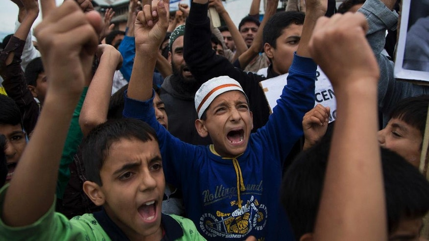 Kashmir Muslims shout pro-freedom slogans in Srinagar, Indian controlled Kashmir, Saturday, Aug. 27, 2016. A strict curfew, a series of communication blackouts and a tightening crackdown have failed to stop some of Kashmir's largest protests against Indian rule in recent years, triggered by the killing of a popular rebel commander on July 8. (AP Photo/Dar Yasin)