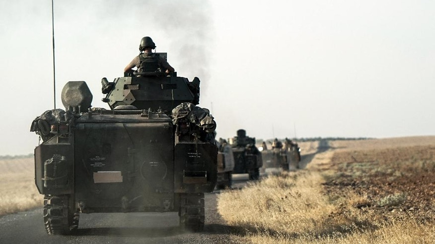 Turkish troops head to the Syrian border, in Karkamis, Turkey, Saturday, Aug. 27, 2016. Turkey on Wednesday sent tanks across the border to help Syrian rebels retake the key Islamic State-held town of Jarablus and to contain the expansion of Syria's Kurds in an area bordering Turkey .(AP Photo/Halit Onur Sandal)