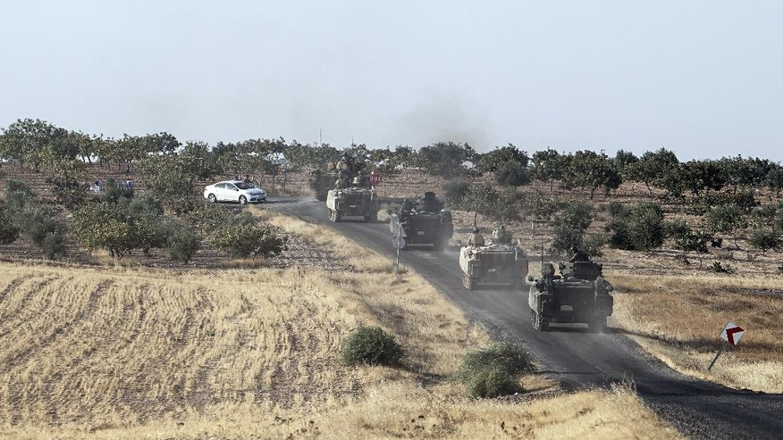 Turkish troops head to the Syrian border, in Karkamis, Turkey, Saturday, Aug. 27, 2016. Turkey on Wednesday sent tanks across the border to help Syrian rebels retake the key Islamic State-held town of Jarablus and to contain the expansion of Syria's Kurds in an area bordering Turkey. (AP Photo/Halit Onur Sandal)
