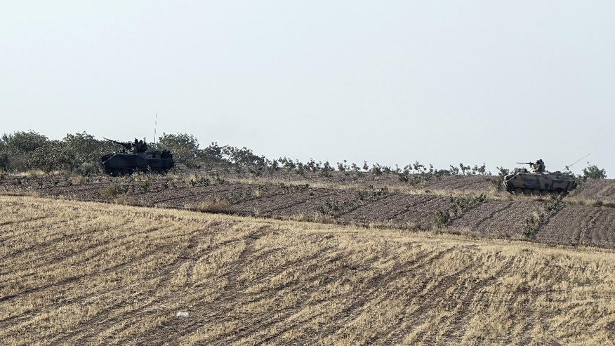 Turkish tanks head to the Syrian border, in Karkamis, Turkey, Saturday, Aug. 27, 2016. Turkey on Wednesday sent tanks across the border to help Syrian rebels retake the key Islamic State-held town of Jarablus and to contain the expansion of Syria's Kurds in an area bordering Turkey. (AP Photo/Halit Onur Sandal)