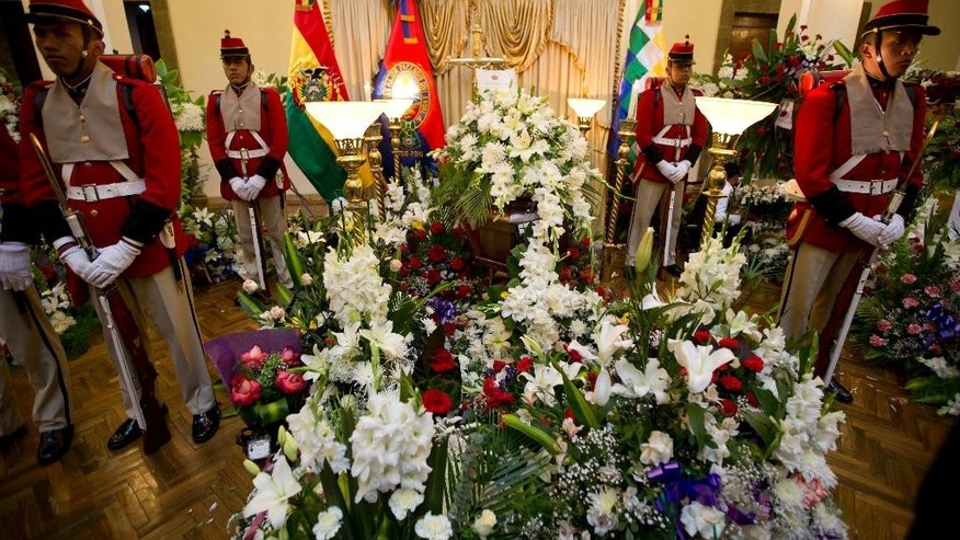 An honor guard stands vigil over Bolivia's Deputy Minister of Internal Affairs Rodolfo Illanes lying in state, inside the government palace in La Paz, Bolivia Friday, Aug. 26, 2016. Striking Bolivian miners kidnapped and beat to death Illanes Thursday, in a shocking spasm of violence following weeks of tension over dwindling paychecks in a region hit hard by falling metal prices. The miners were demanding they be allowed to work for private companies, who promise to put more cash in their pockets. (AP Photo/Juan Karita)