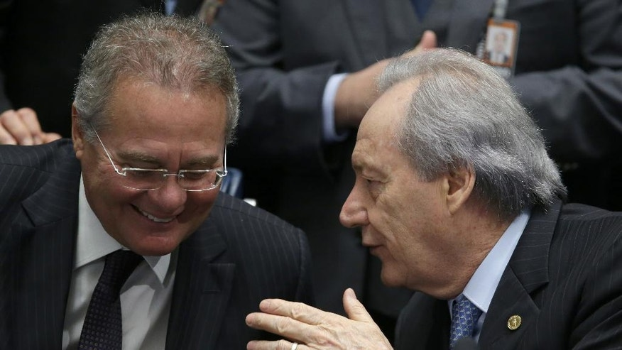 "Brazil's Supreme Court Chief Justice Ricardo Lewandowski, right, talks with Brazil's Senate leader Renan Calheiros, during the impeachment trial of suspended President Dilma Rousseff, in Brasilia, Brazil, Friday, Aug. 26, 2016. The second day of the trial turned into a yelling match and was temporarily suspended on Friday after Calheiros declared ""stupidity is endless"" and sharply criticized a colleague who had questioned the body's moral authority. (AP Photo/Eraldo Peres)"