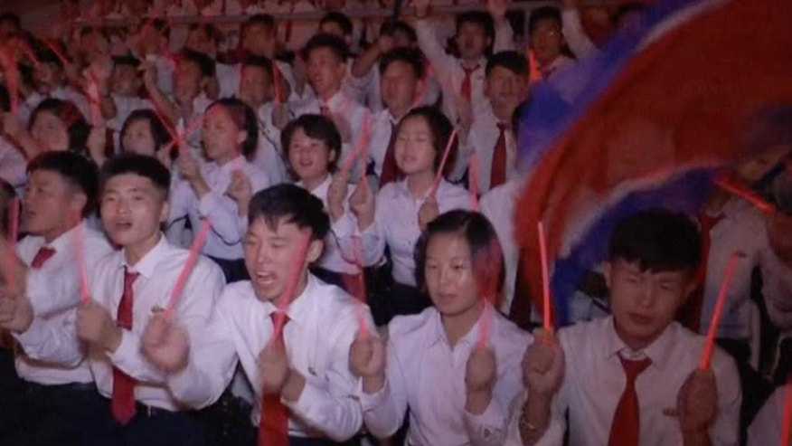 In this image made from video, audience members cheer and wave glow sticks during a celebration of the gathering of the country's main youth league at May Day Stadium in Pyongyang, North Korea, Sunday, Aug. 28, 2016. The Kim Il Sung Socialist Youth League plays a major part in North Korea's social system, with young people agedf 14 to 30 are expected to join and take part in activities ranging from study sessions to helping out in major construction projects. (AP Photo)