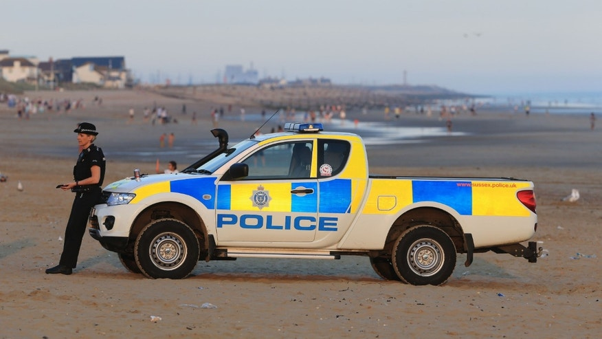 Police on Camber Sands Wednesday.
