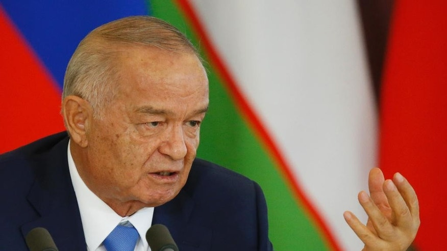 FILE In this Tuesday, April 26, 2016 file pool photo Uzbek President Islam Karimov speaks at a joint news conference with Russian President Vladimir Putin following their meeting in the Kremlin in Moscow, Russia. Uzbekistan's government has issued, Sunday, Aug. 28, 2016, an unusual statement announcing the hospitalization of President Islam Karimov, who has ruled the former Soviet republic in Central Asia for more than 25 years. (Maxim Shemetov/Pool Photo via AP, File)