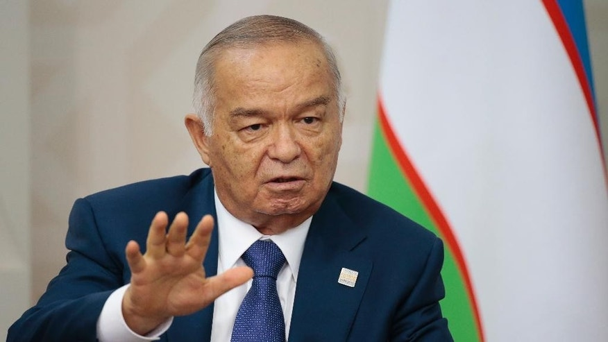 FILE In this file photo taken on Friday, July 10, 2015, Uzbekistan's President Islam Karimov gestures while speaking to Russian President Vladimir Putin during the SCO (Shanghai Cooperation Organization) summit in Ufa, Russia. Uzbekistan's government has issued, Sunday, Aug. 28, 2016, an unusual statement announcing the hospitalization of President Islam Karimov, who has ruled the former Soviet republic in Central Asia for more than 25 years. (AP Photo/Ivan Sekretarev, file)
