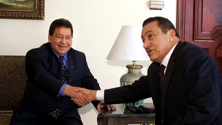 FILE -- In this Jan. 30, 2002 file photo, Egyptian President Hosni Mubarak, right, shakes hands with Israeli Defense Minister Binyamin Ben-Eliezer before their meeting in the Egyptian resort of Sharm el-Sheik. Ben Eliezer, a veteran Israeli politician who held a series of top governmental posts, including defense minister died Sunday, Aug. 28, 2016. He was 80. A native Arabic speaker, Ben Eliezer was on friendly terms with deposed Egyptian leader Hosni Mubarak and other Arab leaders and helped bridge gaps between Israel and the Arab world. (AP Photo/Amr Nabil, File)