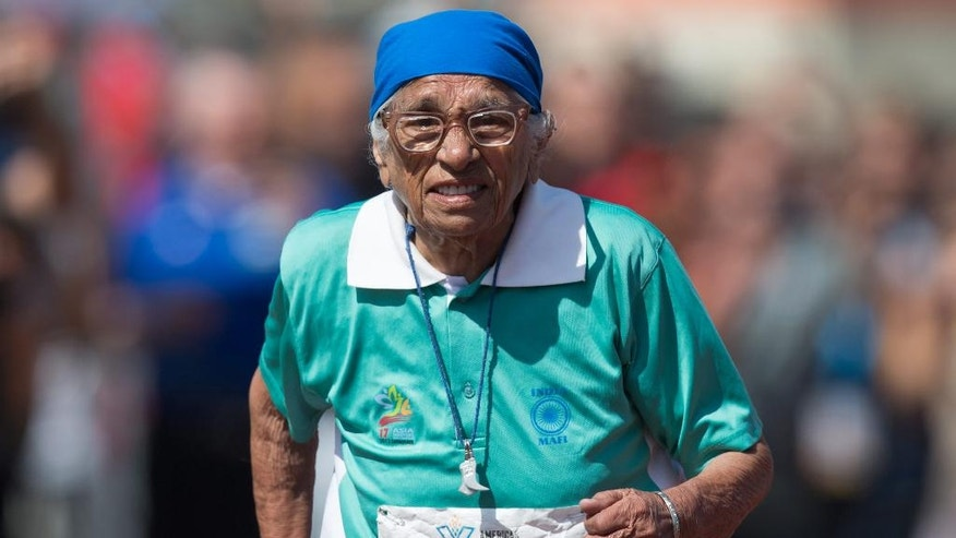 Man Kaur, 100, of India, competes in the 100-meter track and field event at the Americas Masters Games in Vancouver, British Columbia, Monday, Aug. 29, 2016. More than 10,000 athletes aged 30 and older are participating in the games which continue until Sept. 4. (Darryl Dyck/The Canadian Press via AP)