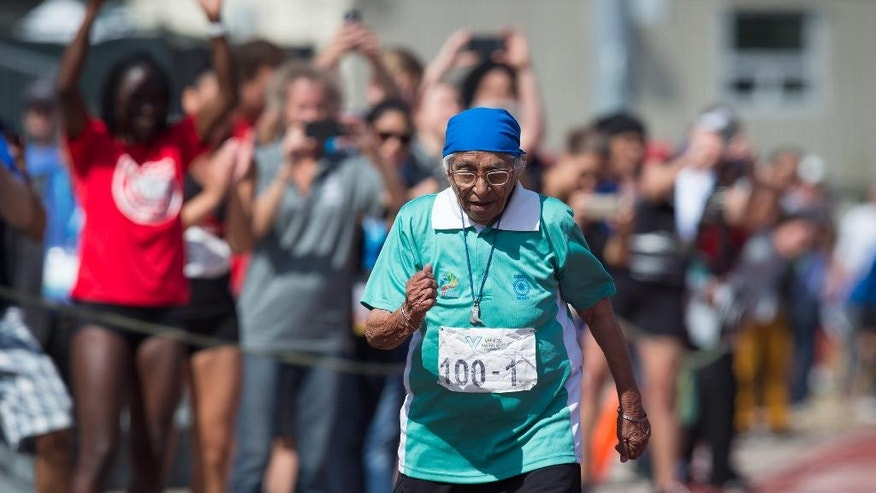Man Kaur, 100, of India, competes in the 100-meter track and field event at the Americas Masters Games in Vancouver, British Columbia, Monday, Aug. 29, 2016. (Darryl Dyck/The Canadian Press via AP)