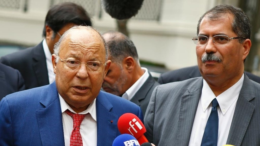 Paris Mosque rector Dalil Boubakeur, left, and Anouar Kbibech, President of the French Council of the Muslim Faith, talk to the media during a meeting with France's Interior minister, in Paris, Monday, Aug. 29, 2016. France's Interior minister Bernard Cazeneuve has gathered leaders of the country's Muslim community, experts and lawmakers to mend relations between Islam and the French state undermined by the burkinis dispute. (AP Photo/Francois Mori)