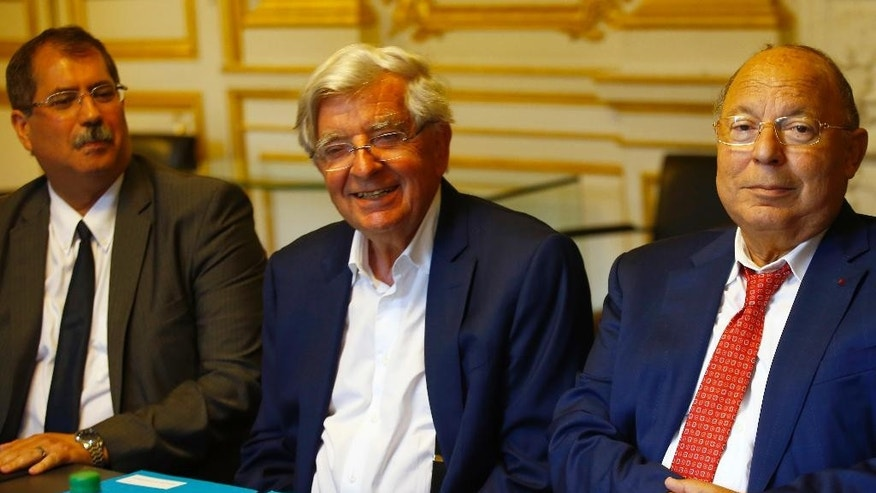 Anouar Kbibech, President of the French Council of the Muslim Faith, Former Interior minister Jean Pierre Chevenement, and Paris Mosque rector Dalil Boubakeur, from left to right, attend a meeting with France's Interior minister, in Paris, Monday, Aug. 29, 2016. France's Interior minister Bernard Cazeneuve has gathered leaders of the country's Muslim community, experts and lawmakers to mend relations between Islam and the French state undermined by the burkinis dispute. (AP Photo/Francois Mori)