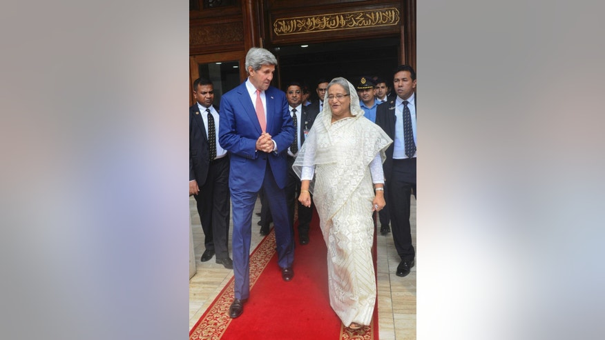 U.S. Secretary of State John Kerry, left, is received by Bangladesh Prime Minister Sheikh Hasina at the Prime Minister's office in Dhaka, Bangladesh, Monday, Aug. 29, 2016. Kerry called Monday for Bangladesh to step up efforts to fight extremist violence and protect and promote human rights amid increasing concern about terrorism in the South Asian nation in the wake of a series of militant attacks. (AP Photo)