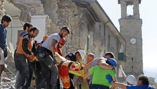 A victim is carried on a stretcher from a collapsed building after an earthquake, in Amatrice, central Italy, Wednesday, Aug. 24, 2016. A devastating earthquake rocked central Italy early Wednesday, collapsing homes on top of residents as they slept. At least 23 people were reported dead in three hard-hit towns where rescue crews raced to dig survivors out of the rubble, but the toll was expected to rise as crews reached homes in more remote hamlets. (AP Photo/Alessandra Tarantino)