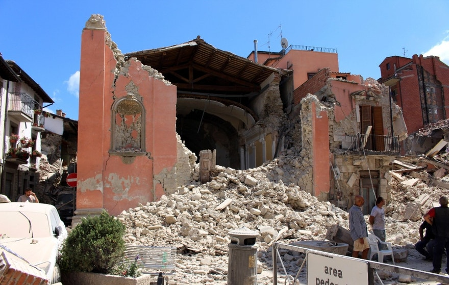 This photo taken Wednesday Aug. 24, 2016 shows the San Giovanni church in Amatrice, central Italy,  where a 6.1 earthquake struck just after 3:30 a.m. Wednesday. Only hours after last week's quake devastated several medieval hill towns in central Italy, members of the national police squad of art experts were already climbing around mounds of rubble to photograph hundreds of centuries-old churches, with missing roofs, torn-away frescoes or gaping holes where stained glass once filtered sunlight. (Italian Carabinieri via AP)