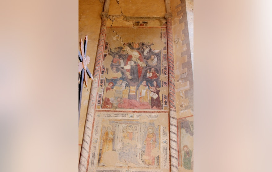 This photo taken on Wednesday Aug. 24, 2016 shows a fresco inside the Basilica of San Francesco in Amatrice, central Italy, where a 6.1 earthquake struck just after 3:30 a.m. Wednesday. Only hours after last week's quake devastated several medieval hill towns in central Italy, members of the national police squad of art experts were already climbing around mounds of rubble to photograph hundreds of centuries-old churches, with missing roofs, torn-away frescoes or gaping holes where stained glass once filtered sunlight. (Italian Carabinieri via AP)