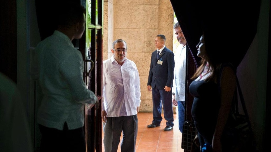 Commander of the Revolutionary Armed Forces of Colombia or FARC, Rodrigo Londono, better known as Timochenko or Timoleon Jimenez arrives at a press conference in Havana, Cuba, Sunday, August 28, 2016. The commander of Colombia's biggest rebel movement says its fighters will permanently cease hostilities with the government beginning with the first minute of Monday, as a result of their peace accord for ending five decades of war.(AP Photo/Ramon Espinosa)