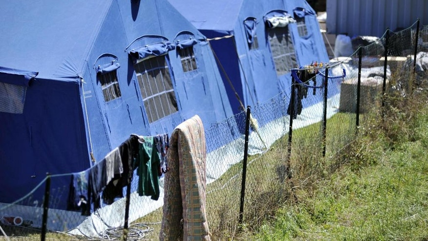 A view of the tent camp that was set in Arquata Del Tronto, central Italy, Monday, Aug. 29, 2016. With thousands left homeless after Italy's earthquake, authorities are debating how to provide warmer, sturdier housing for them besides the rows of emergency blue tents set up in the Apennine Mountains, where even summer nights can get chilly. (Cristiano Chiodi/ANSA via AP)
