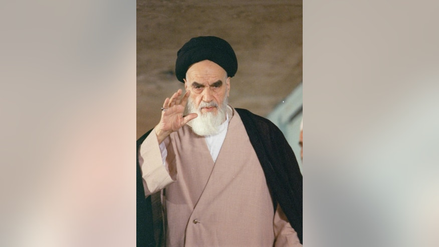 "FILE -- In this May 13, 1988 file photo, then Iranian leader Ayatollah Ruhollah Khomeini greets well-wishers before casting his vote in the final round of Iran's Parliamentary Elections.  In August, 2016, a website in Grand Ayatollah Hossein Ali Montazeri's honor, run by his family, released a tape recording of Montazeri that has rekindled memories of the Islamic Republic's mass execution of prisoners in 1988. The recording has Montazeri condemning Iran's execution of thousands of prisoners at the end of the country's bloody war with Iraq in 1988. He warns those gathered they've committed ""the biggest crime in the history of the Islamic Republic,"" while criticizing them for misleading the country's then-ailing supreme leader, Ayatollah Ruhollah Khomeini. (AP Photo/Sayaad, File)"