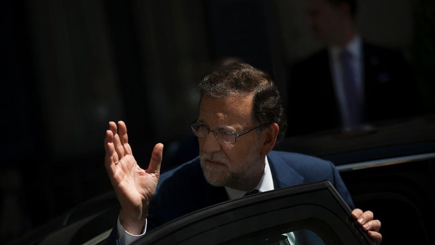 Spain's acting Prime Minister and Popular Party leader Mariano Rajoy leaves after his meeting with Socialist Party leader Pedro Sanchez at the Spanish parliament in Madrid, Monday, Aug. 29, 2016. Rajoy is meeting with Sanchez in a last-ditch effort to convince him not to scupper the premier's bid to form a government this week and end the country's eight-month political impasse following two inconclusive elections. (AP Photo/Francisco Seco)