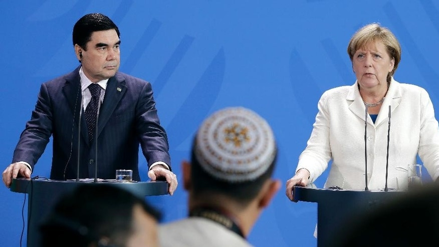 German Chancellor Angela Merkel, right, and the President of Turkmenistan, Gurbanguly Berdimuhamedow, left, address the media during a joint news conference as part of a meeting at the chancellery in Berlin, Germany, Monday, Aug. 29, 2016. (AP Photo/Michael Sohn)