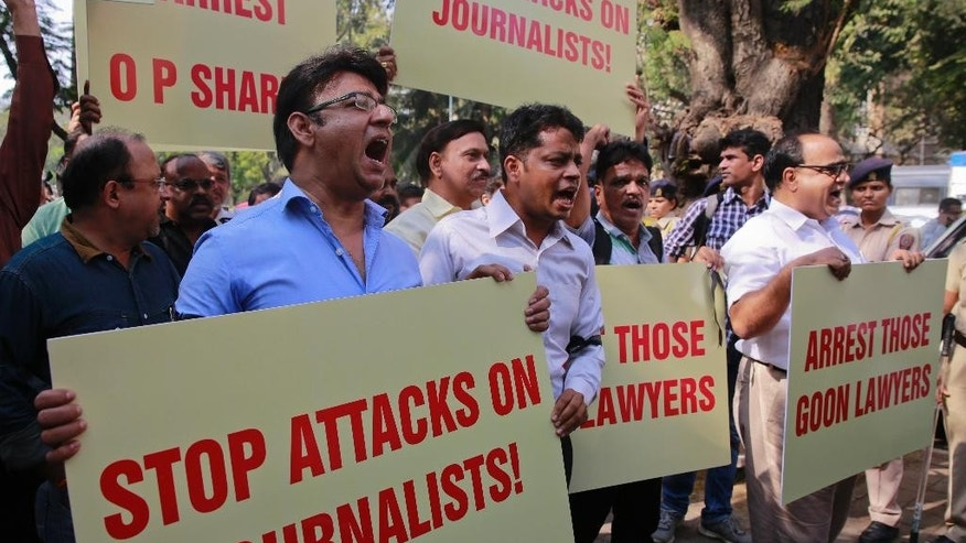 FILE - In this Feb. 17, 2016, Indian journalists hold placards during a protest against attack on journalists in Mumbai. The Committee to Protect Journalists counted 27 journalists killed for their work since 1992, and noted it was still investigating more than two dozen cases to determine if those journalists' deaths were also work related. (AP Photo/Rafiq Maqbool, File)