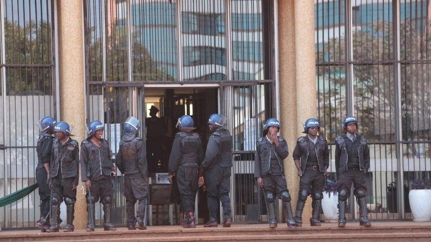 Armed Zimbabwean Prison guards patrol outside the courts in Harare, Monday, Aug. 29, 2016. 67 suspected demonstrators made a court appearance following their arrests on Friday during protests called by opposition political parties who were advocating for reforms in the Southern African nation. The protests were the first time that the fractured opposition has joined hands in a single unified action to confront President Robert Mugabe's government since 2007. (AP Photo/Tsvangirayi Mukwazhi)