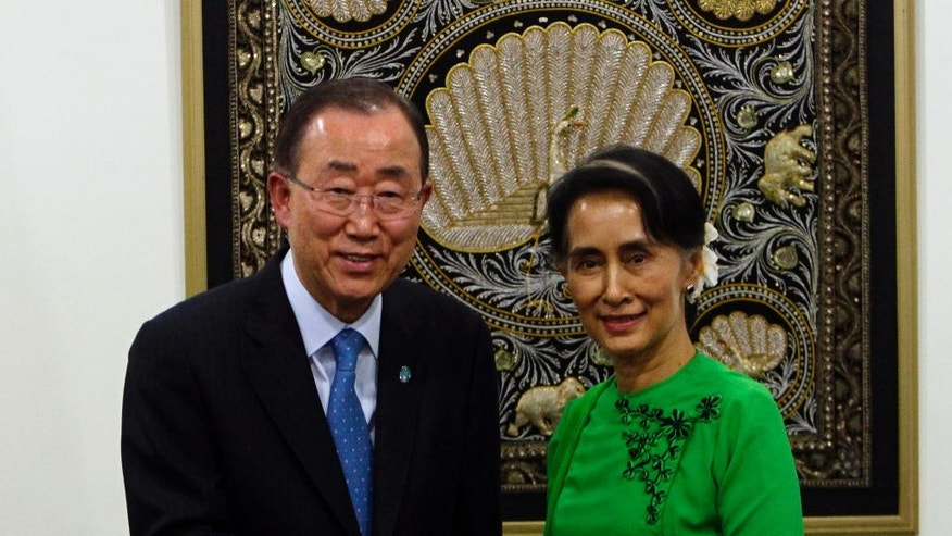 Myanmar Foreign Minister Aung San Suu Kyi, right,  shakes hands with UN Secretary General Ban Ki-moon, left,  after their press conference at the Foreign Ministry office August, 30,2016, in Nay Pyi Taw, Myanmar. (AP Photo/Aung Shine Oo)