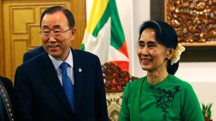 Myanmar's Foreign Minister Aung San Suu Kyi, right,  talks with U.N. Secretary-General Ban Ki-moon during their meeting at Foreign Ministry office  Tuesday, Aug. 30, 2016, in Naypyitaw, Myanmar. (AP Photo/Aung Shine Oo)