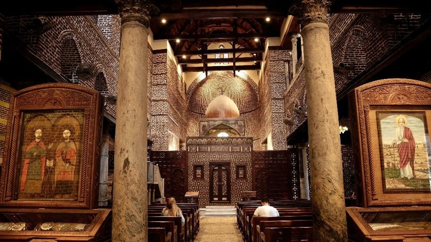 A man and woman pray at the Cavern Church, and the martyrs Sergius and Bacchus, famously known as the Abu Serga Church, in Old Cairo, Egypt, Tuesday, Aug. 30, 2016. After long hoping for an end to restrictions on the building of churches, many of Egypt's Christians are infuriated and feeling betrayed after lawmakers on Tuesday passed a law giving authorities broad powers to veto construction for vague reasons including worries over 'national security.' (AP Photo/Nariman El-Mofty)