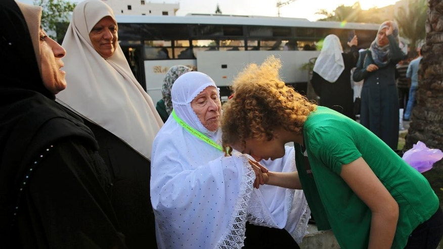 A Palestinian says goodbye to a relative before leaving to the holy city of Mecca, for the annual hajj pilgrimage,  in Gaza City, early Tuesday, Aug. 30, 2016. Hundreds of Palestinian pilgrims are leaving Gaza through the Rafah border crossing with Egypt on their way to Mecca, Saudi Arabia, for hajj. Egypt has agreed to keep the crossing open for three days to allow thousands of people to cross. (AP Photo/Adel Hana)