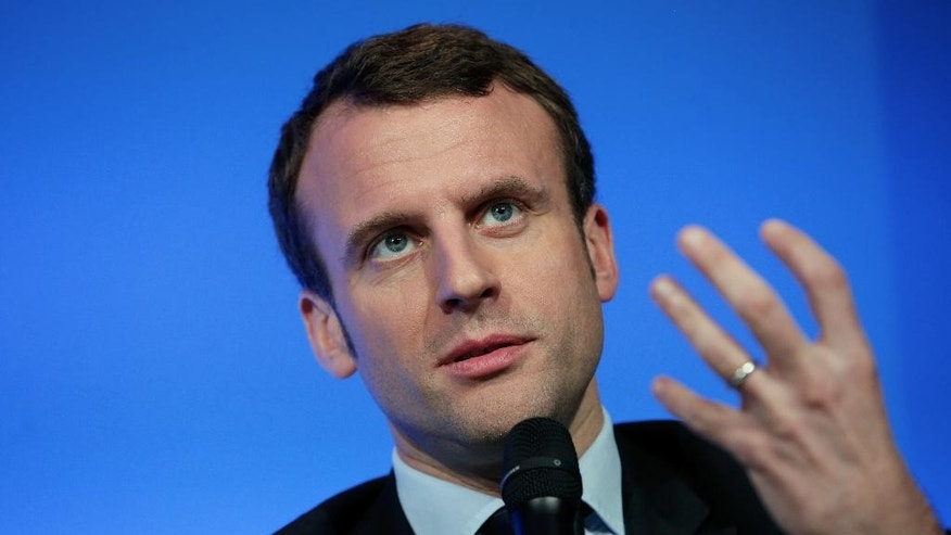FILE - In this March 14, 2016 file photo, Economy Minister Emmanuel Macron gives a press conference, in Paris. Macron, an outspoken former investment banker who has encouraged start-ups and more labor flexibility, has quit the socialist government Tuesday Aug. 30, 2016 amid speculation that he is considering a presidential bid. (AP Photo/Thibault Camus, File)