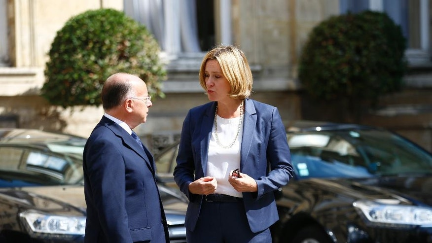 French Interior Minister Bernard Cazeneuve, left, welcomes Britain's Home Secretary Tuesday Aug. 30, 2016 in Paris. Tempers are rising among migrants squeezed in record numbers into a shrinking slum camp in France's port city of Calais, where hours-long waiting lines for food and showers and the tightening grip of security forces are leaving emotions raw. (AP Photo/Francois Mori)
