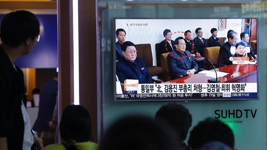 "People watch a TV screen showing a file image of Kim Yong Jin, center, a vice premier on education affairs in North Korea's cabinet, at the Seoul Railway Station in Seoul, South Korea, Wednesday, Aug. 31, 2016. North Korea has executed a vice premier and banished two other top officials to rural areas for re-education, South Korean officials said Wednesday. The letters read "" North Korea has executed Kim Yong Jin and banished Kim Yong Chol and Choe Hwi. (AP Photo/Ahn Young-joon)"