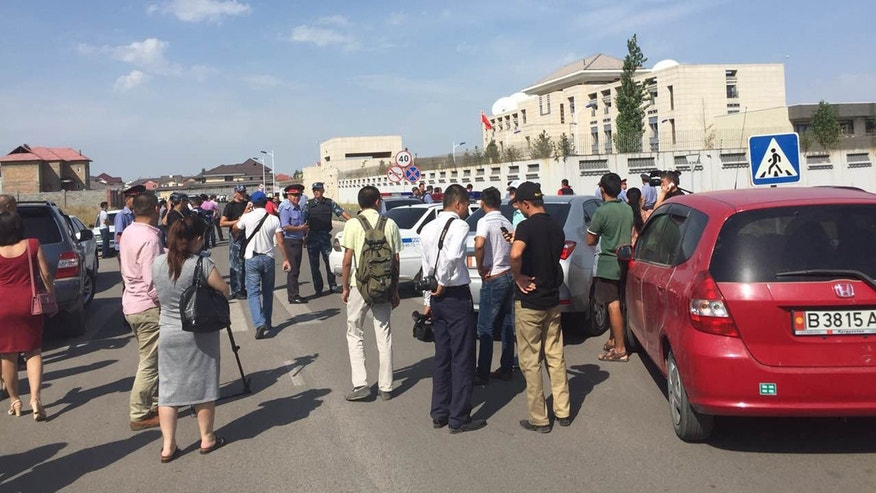 Aug. 30, 2016: People gather near the site of an explosion in Bishkek, Kyrgyzstan.