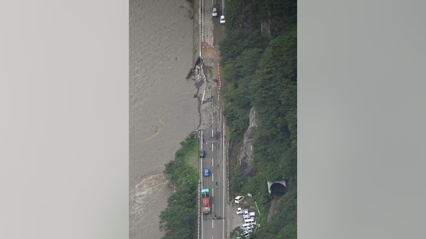 A part of Route 10 is damaged by floodwaters in Miyako city, Iwate prefecture, Japan, Wednesday, Aug. 31, 2016, after Typhoon Lionrock slammed into northern Japan on Tuesday evening. (Kyodo News via AP)